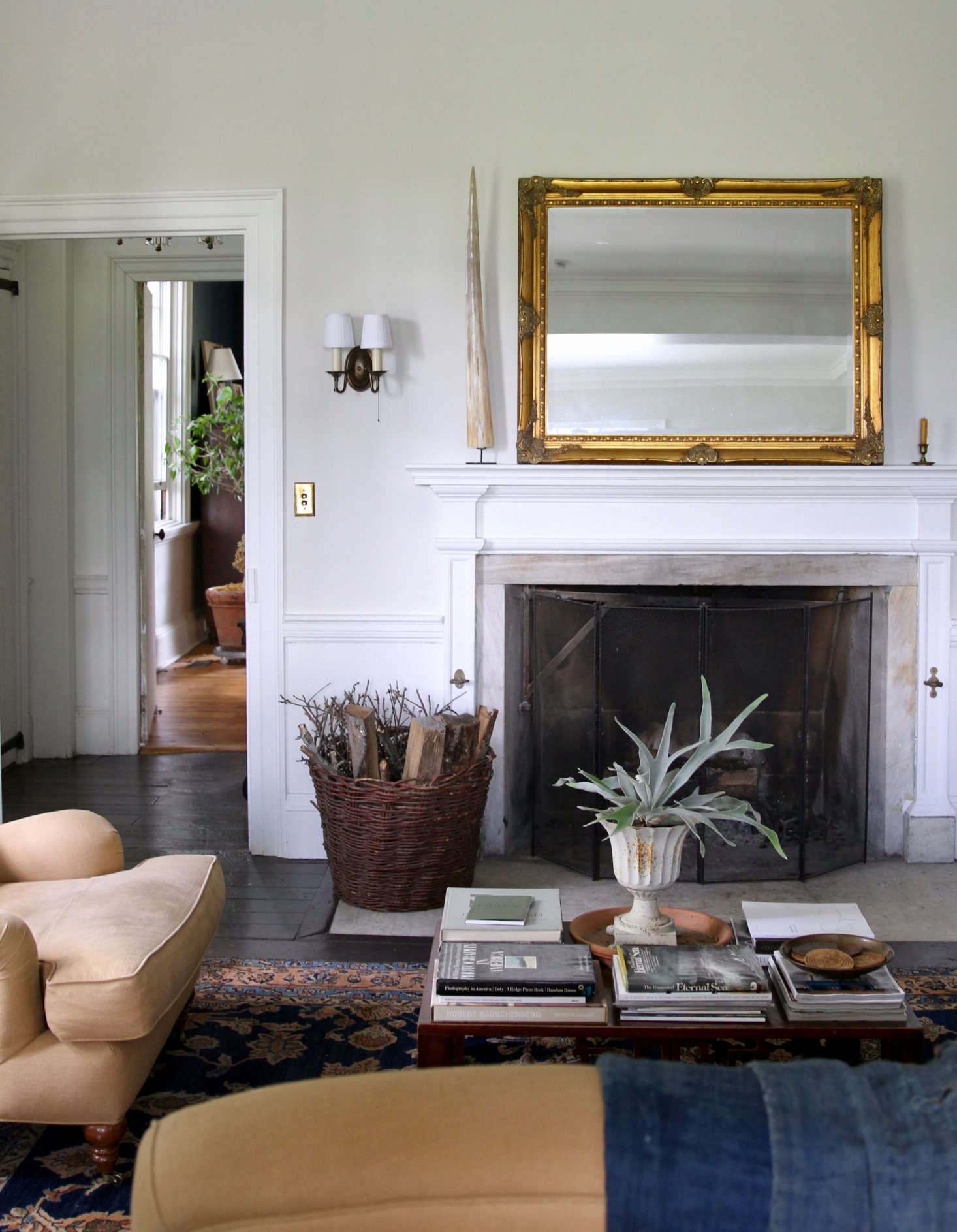 Two parlors on the first floor provide ample space to relax and unwind. Pictured is the back parlor.
