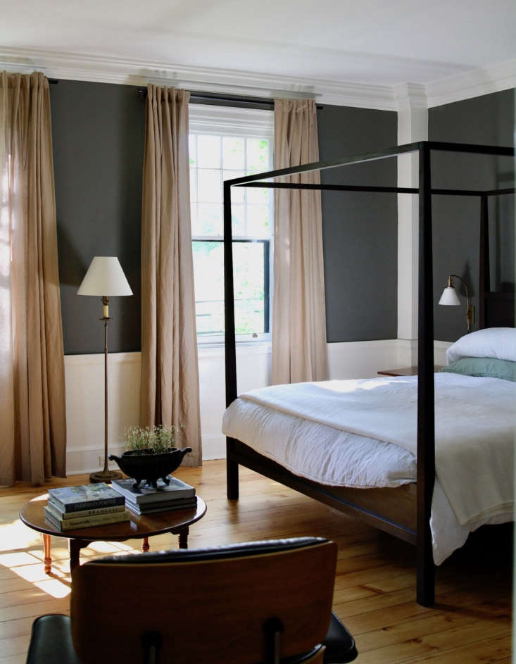 Guest room #3 features a four-poster bed. The walls are painted Kendall Charcoal, the trim Glacier White.