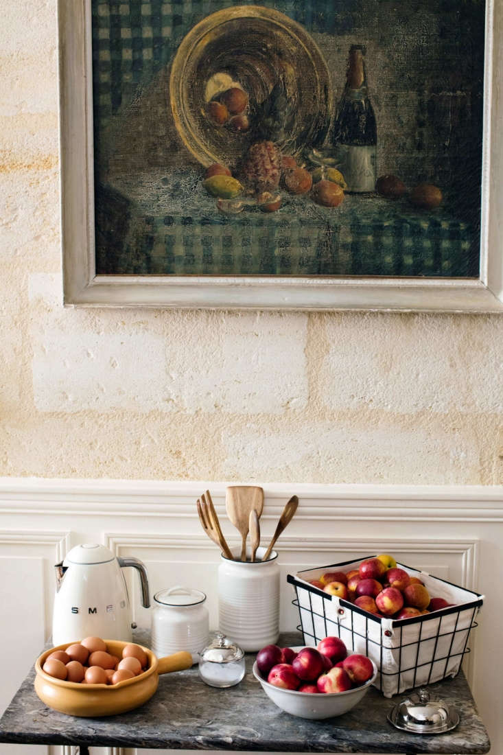 In the French Kitchen with Mimi Thorisson A New Collection from Zara Home An Earthenware Utensil Holder(\$35.90) and fresh eggs on a side table.