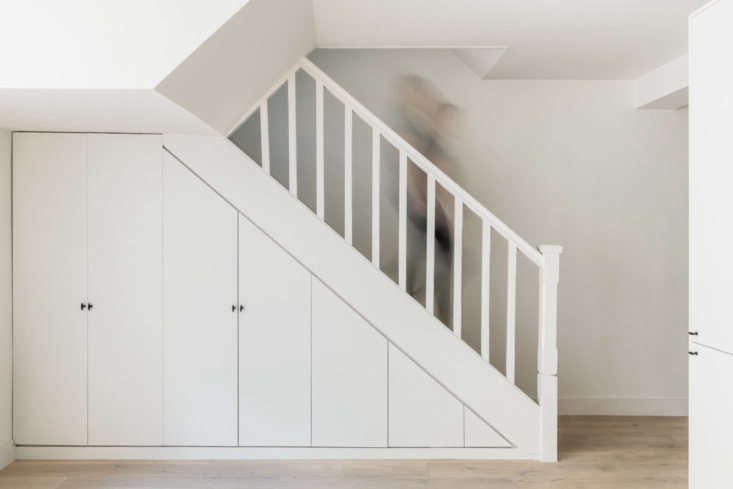 The cast iron pulls show up here on closets integrated into the staircase. The flooring is engineered oak by Havwoods. &#8