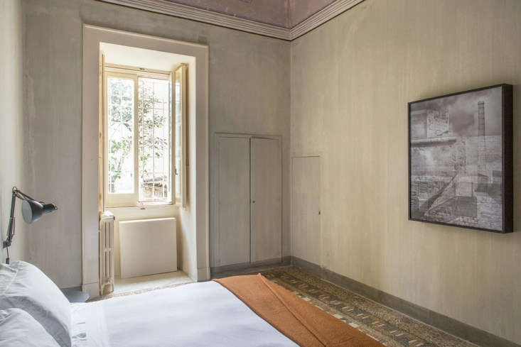 A bedroom in a Junior Suite. Note the nearly invisible doors set into the textured walls.