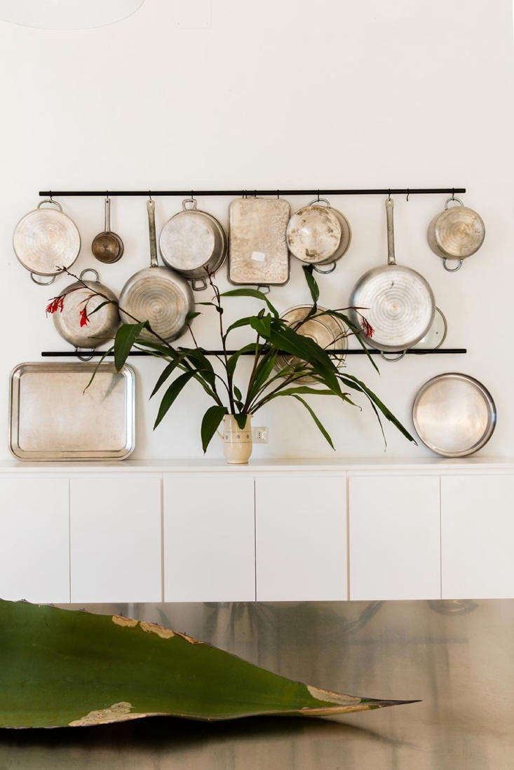 Utilitarian pots and pans become a practical display when hung from s-hooks.