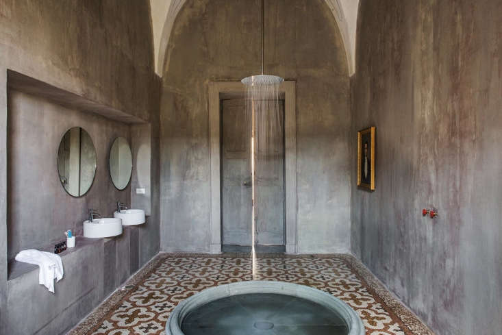 The bathroom in a Royal Junior Suite has the feel of an ancient bath.
