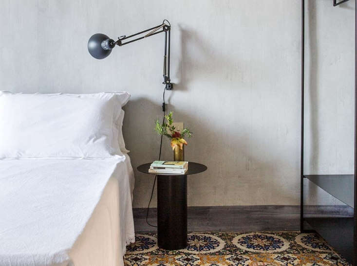 A wall-mounted reading lamp. When the interiors are this spare, the cords become part of the design.