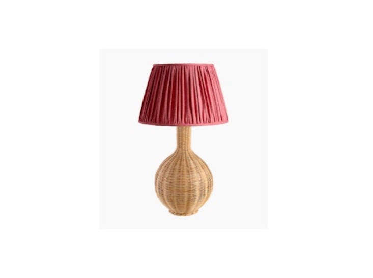 Soane employs three dedicated weavers with a combined experience of 0 years between them. Pictured is the classic Rattan Bottle Lamp.