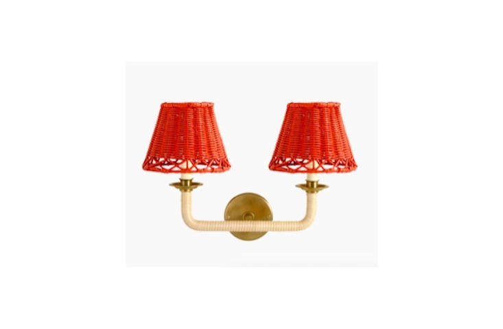 The classic double arms of the Vault Wall Light are wrapped in rattan.
