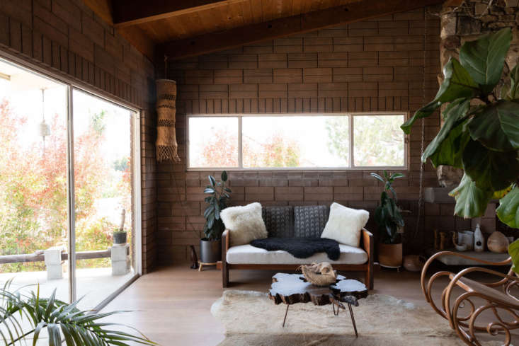 wood paneled ceilings and brick walls keep the house cool on hot days. hanging  11