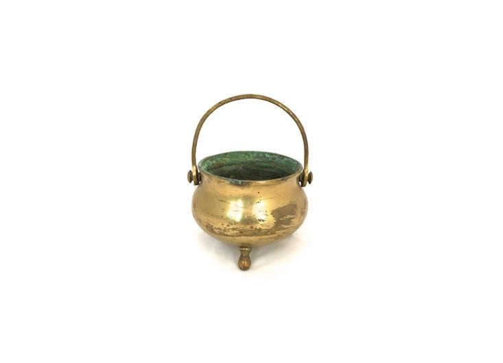 This Vintage Rustic Brass Cauldron has a diameter of 4.5 inches, perfect for corralling flatware; $3loading=