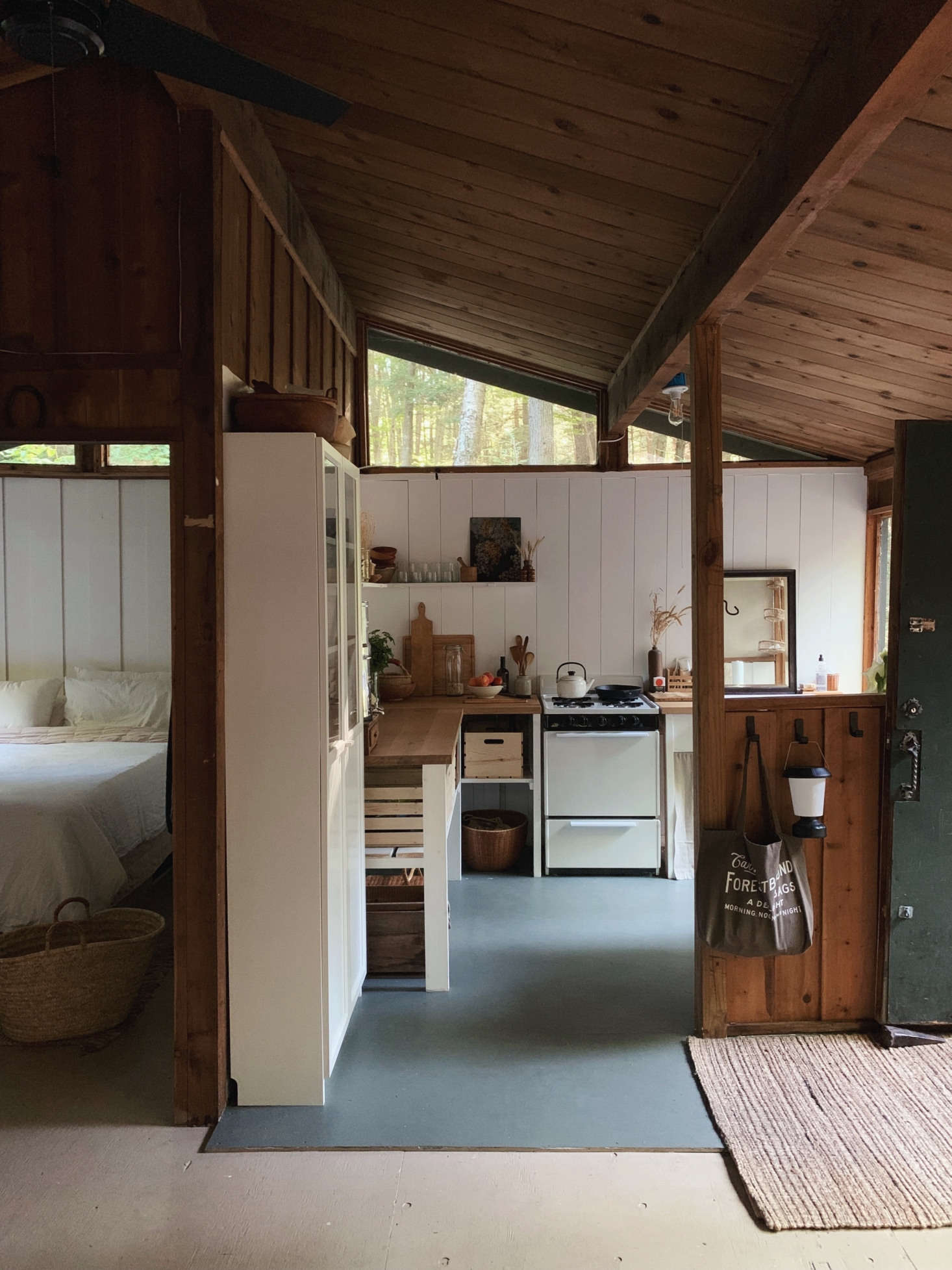 Inside the small cabin, with the newly rehabbed kitchen straight ahead.