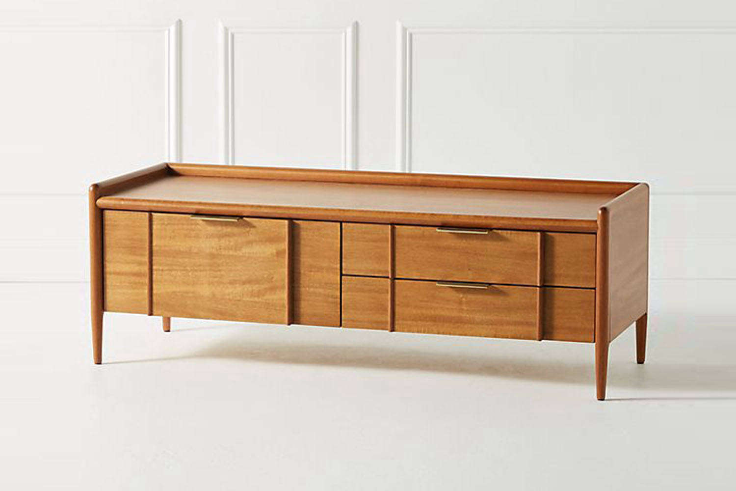 The Quincy Storage Bench in cedar and brass is $598 at Anthropologie.