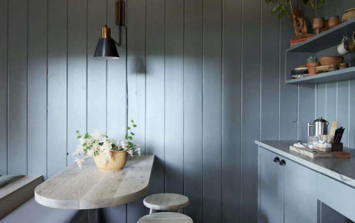 The kitchenette and breakfast nook in the cabin designed by Vancouver studio We.The.Nomads.
