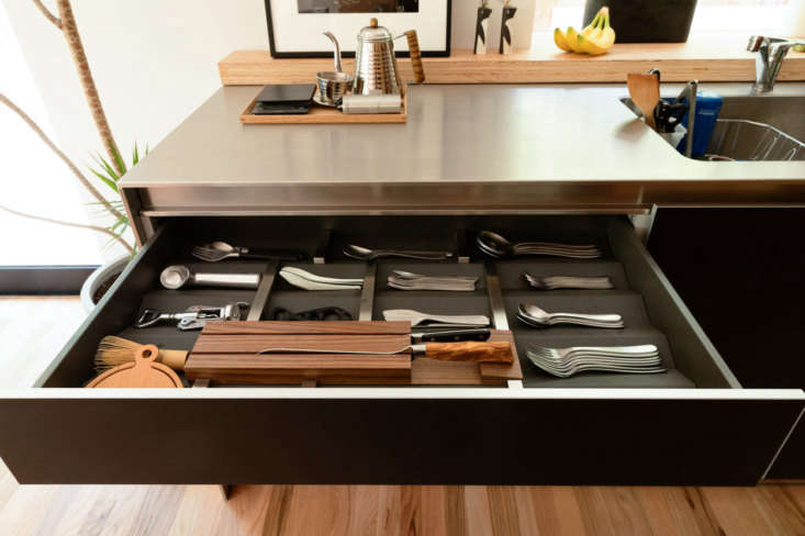 the family&#8\2\17;s cutlery drawer is a model of order. their coffee pot,  11