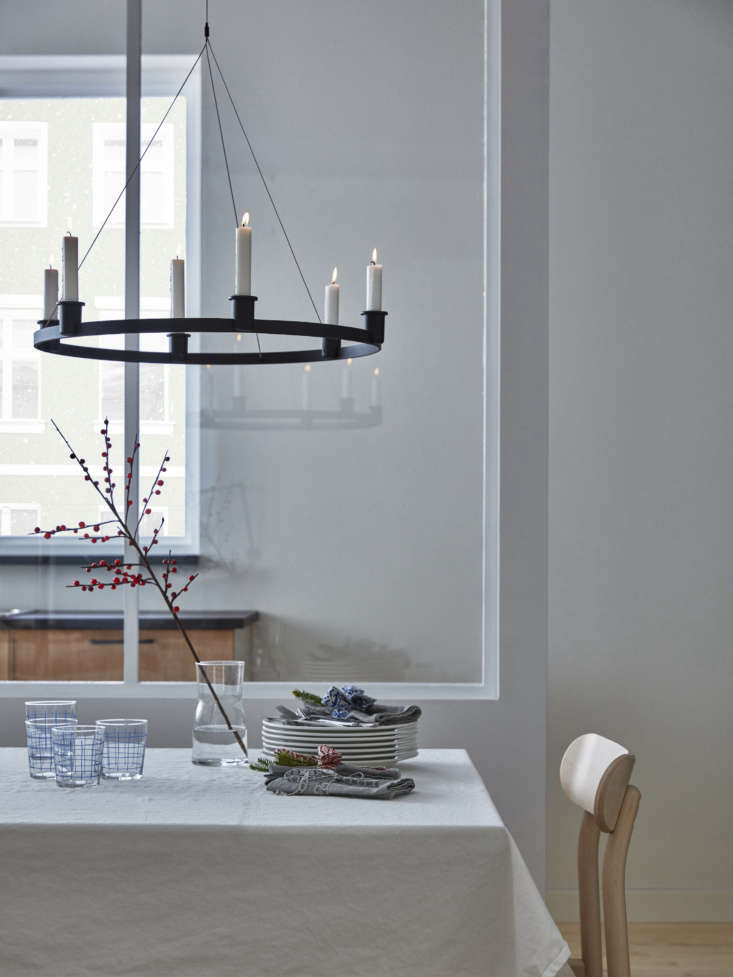 the powder coated aluminum and steel chandelier holds six candles; \$49.99. 13