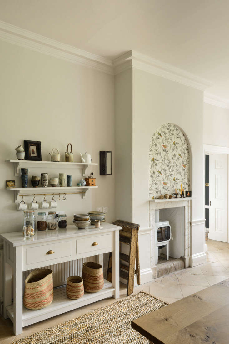 across from the island is a console set up for tea making. whimsical wallpaper  14