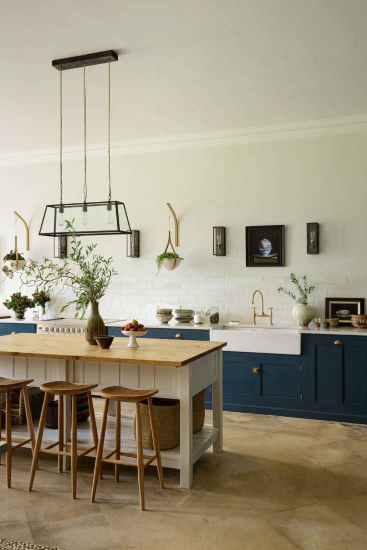 while the cabinets are traditional, the lighting, all by original btc, is thoro 9