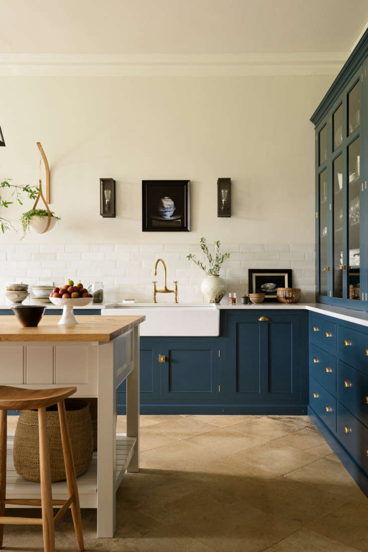the kitchen island, painted off white, is topped with oak. the bum stools are f 13