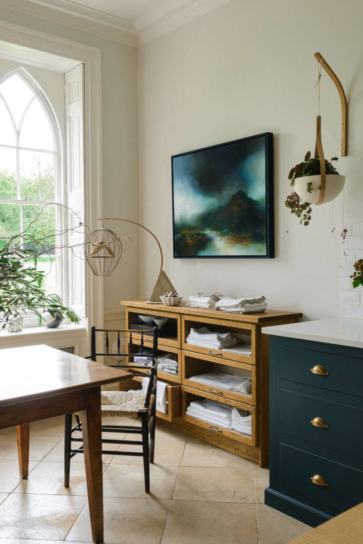 the glass sideboard, for storing kitchen linens, is from devol&#8\2\17;s ha 16