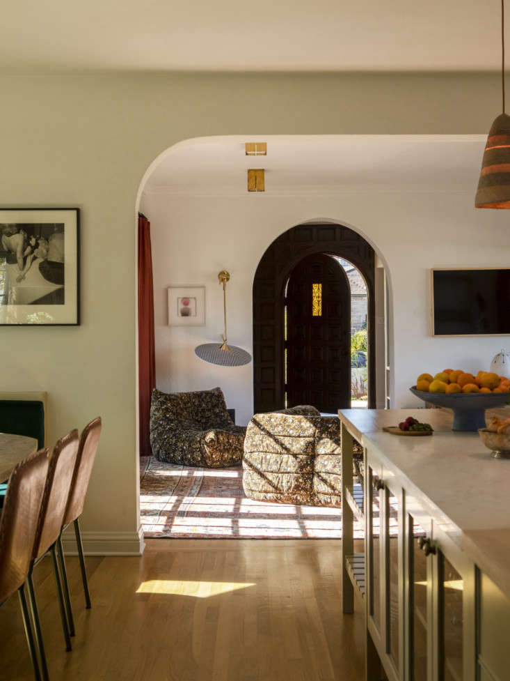 LA Autumnal A 1920s House Makeover Composed in Jewel Tones Not wanting a formal dining area, the family turned the room off the kitchen into a den.