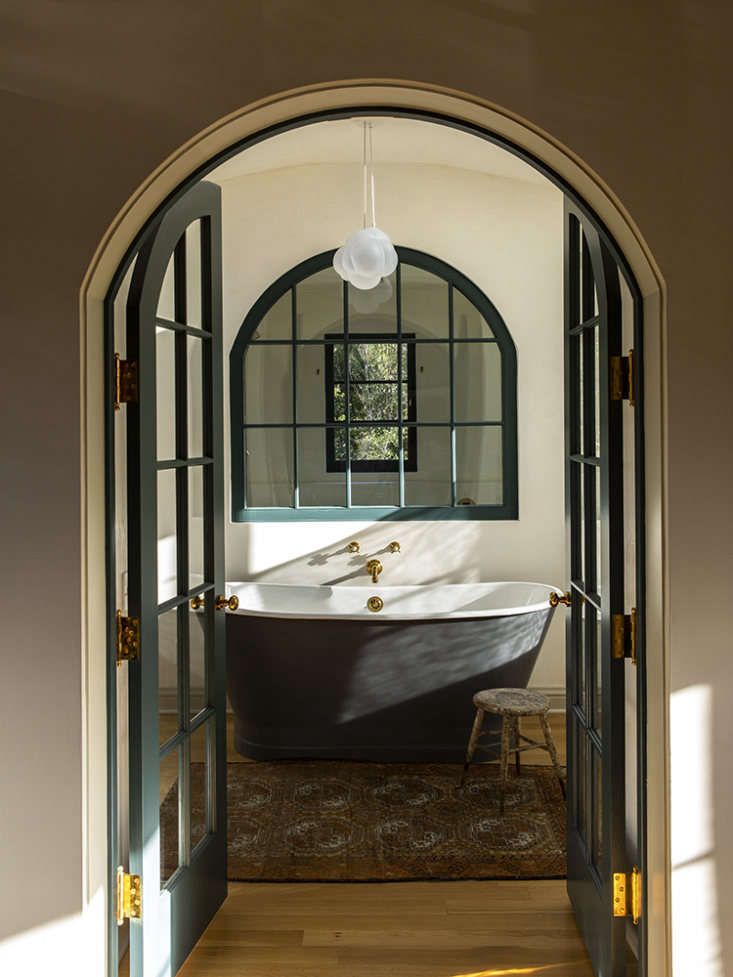LA Autumnal A 1920s House Makeover Composed in Jewel Tones Three arched entries now lead to the bath, shower, and WC. &#8\2\20;The room had a dropped ceiling and no windows,&#8\2\2\1; says McKuin, who added two skylights and four windows (that&#8\2\17;s an interior window shown here, looking into the shower).
