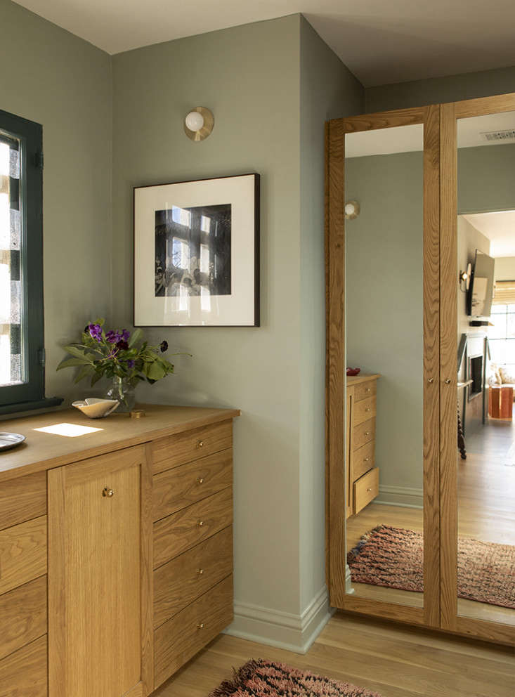 LA Autumnal A 1920s House Makeover Composed in Jewel Tones The new dressing area is fitted with oak built ins.