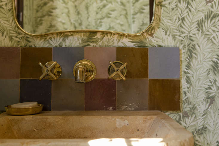 The backsplash is composed of zellige, Moroccan Terracotta Tiles, from Clé in a mix of colors that Merrill and McKuin arranged on the spot. &#8