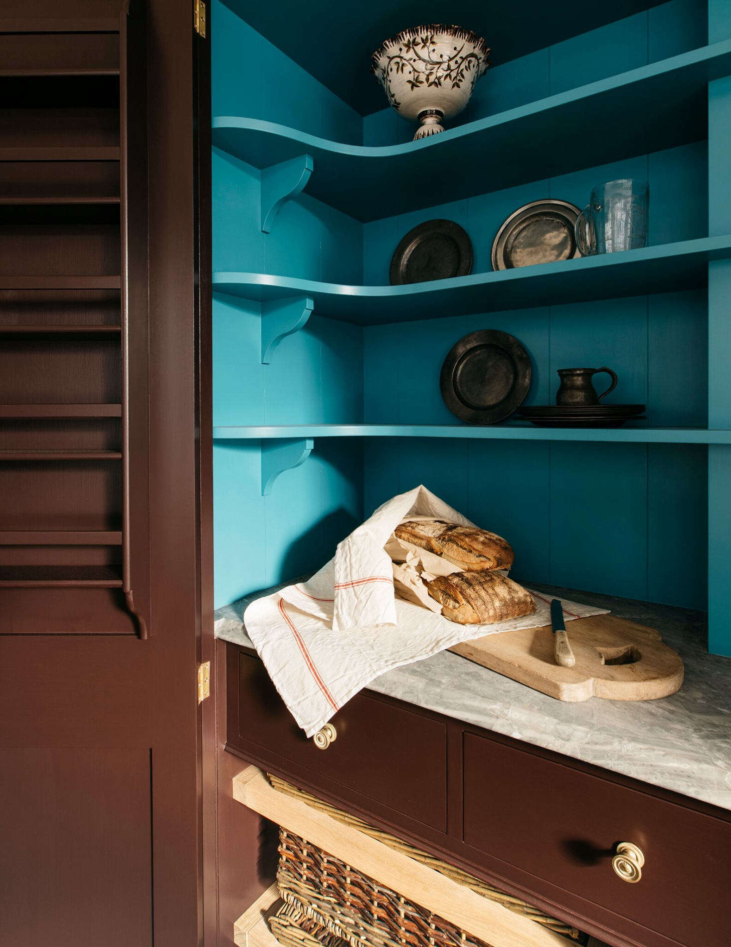 Slide-out baskets, tucked in the lower level of the cupboard, are ideal for fruit and veg storage.