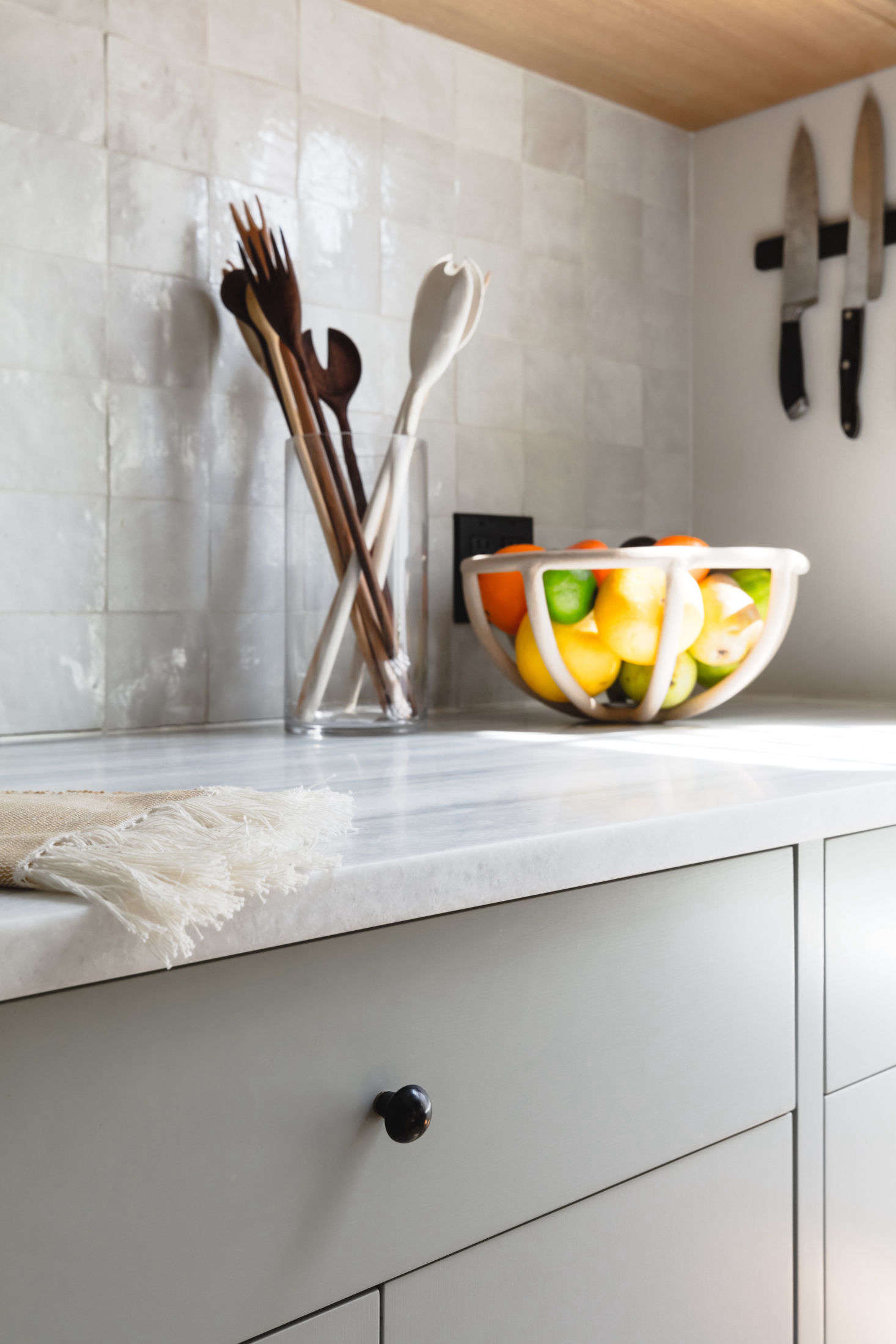 The backsplash is tiled with with Weathered White Zellige from Clé that lends the requested human touch: &#8