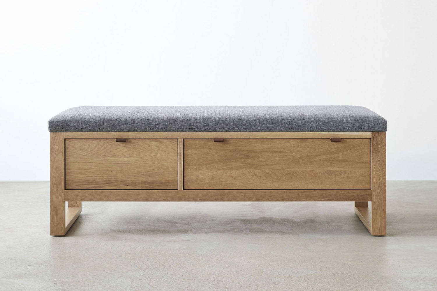 At Unison Home, the Fulton Charcoal Storage Bench is made of solid white oak with an upholstered seat; $loading=