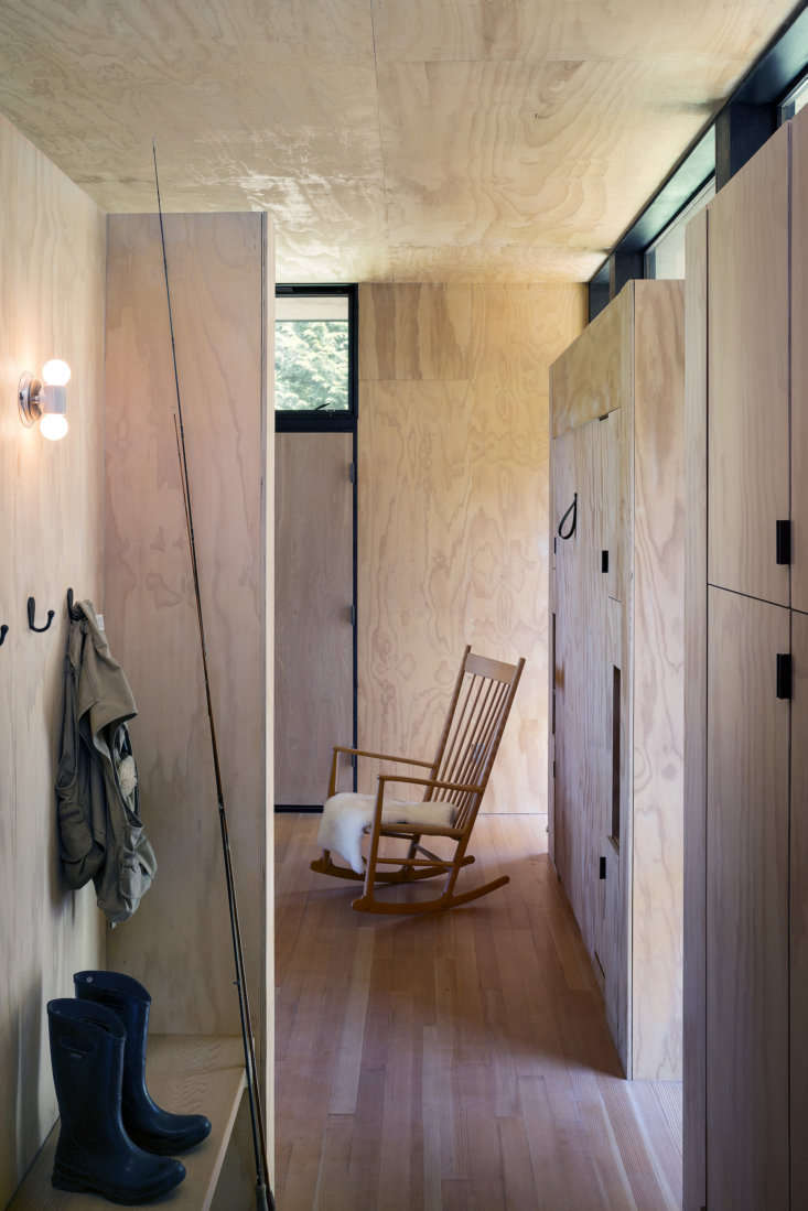the entry into the main cabin. just beyond is a hans wegner rocking chair and a 10