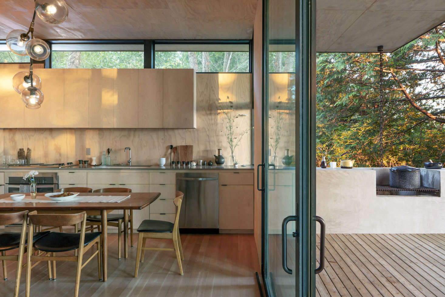 The concrete kitchen counter extends into an outdoor kitchen on the deck.