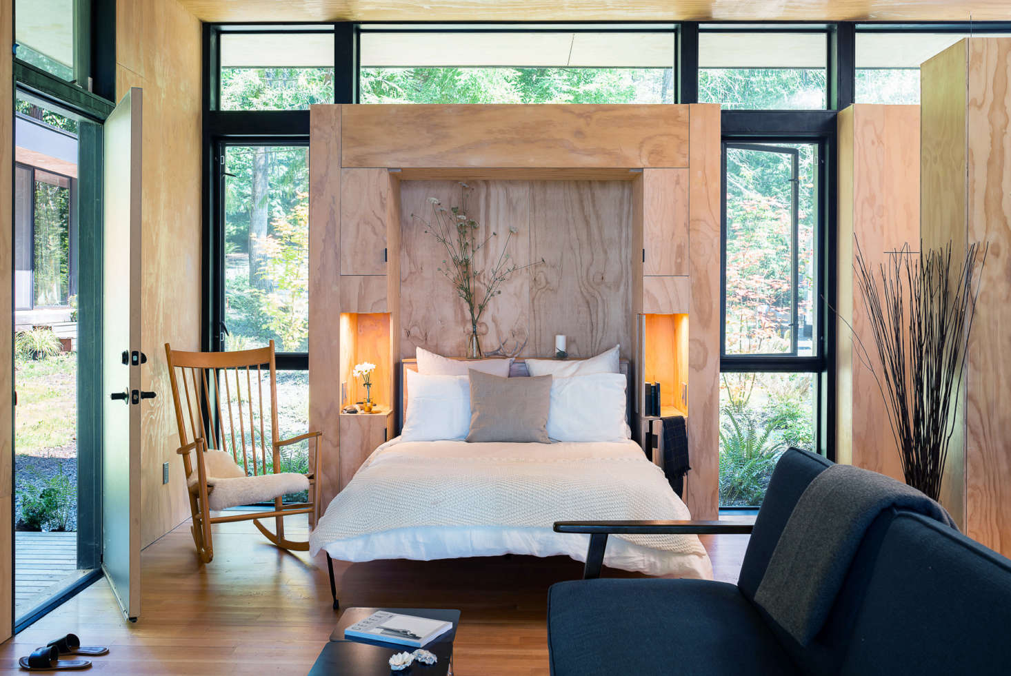Wittman Estes integrated the Murphy bed into a cabinet with side tables, linen storage, and reading lights.