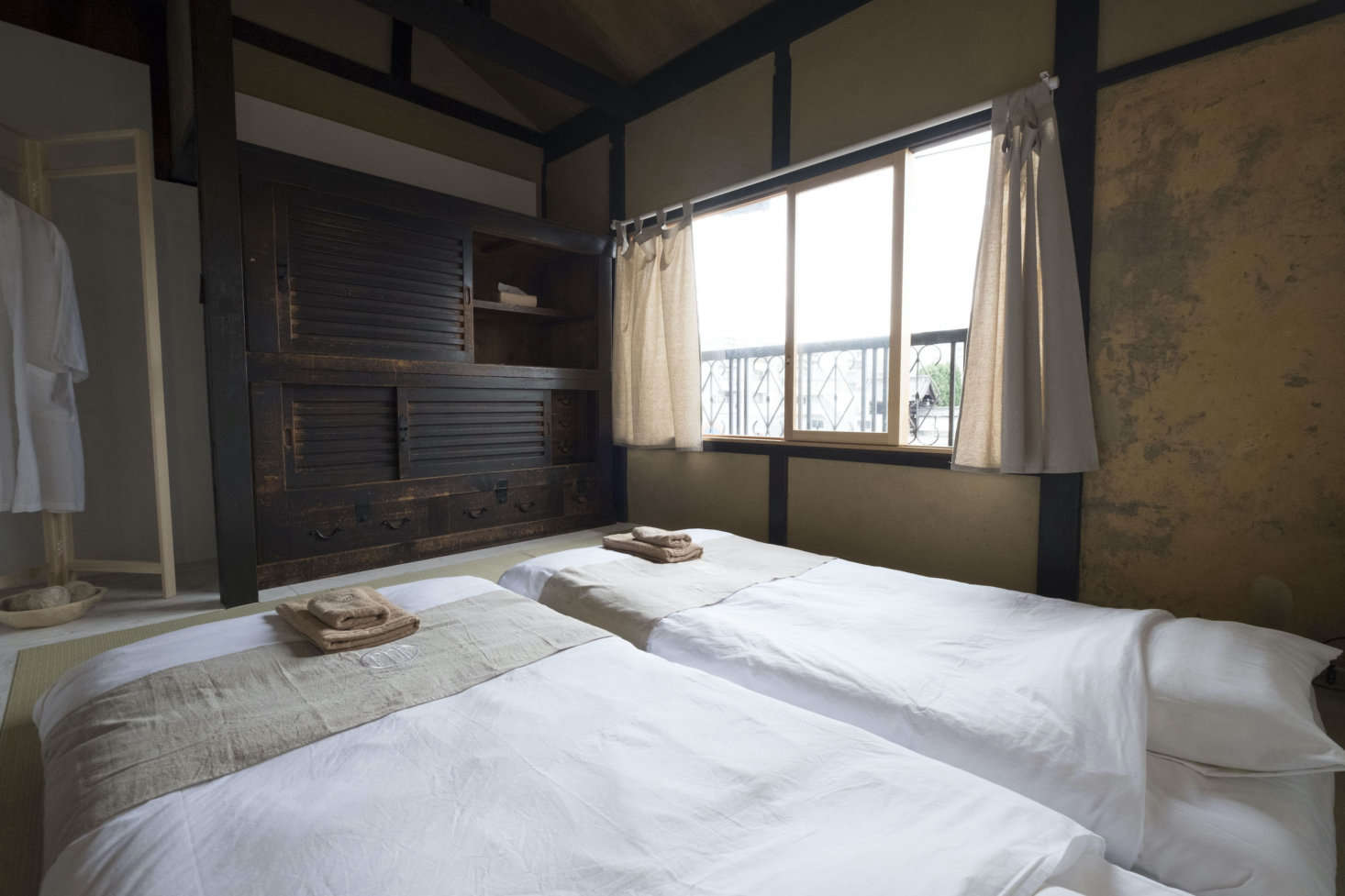 Two of the three bedrooms have twin futons on tatami mats. Temperature Studio in Taiwan designed the robes and towels, which also appear in the Day in Khaki shop. Stay tuned: a second historic house is in the process of being renovated as a rental.