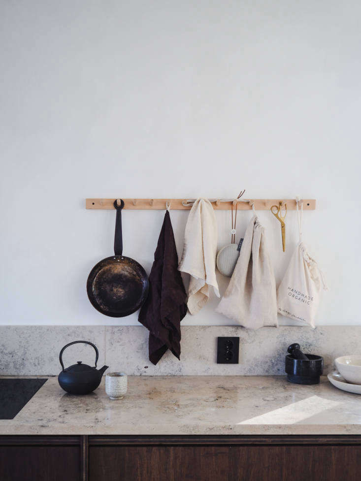A Birch Hook Rack keeps crucial kitchen tools off the counter. Discover more of the many uses for peg rails in our book Remodelista: The Organized Home, and for sources see Object Lessons: The Shaker Peg Rail.