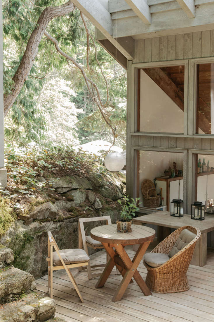 A tranquil covered outdoor space. Note the large windows that offer views into the kitchen.