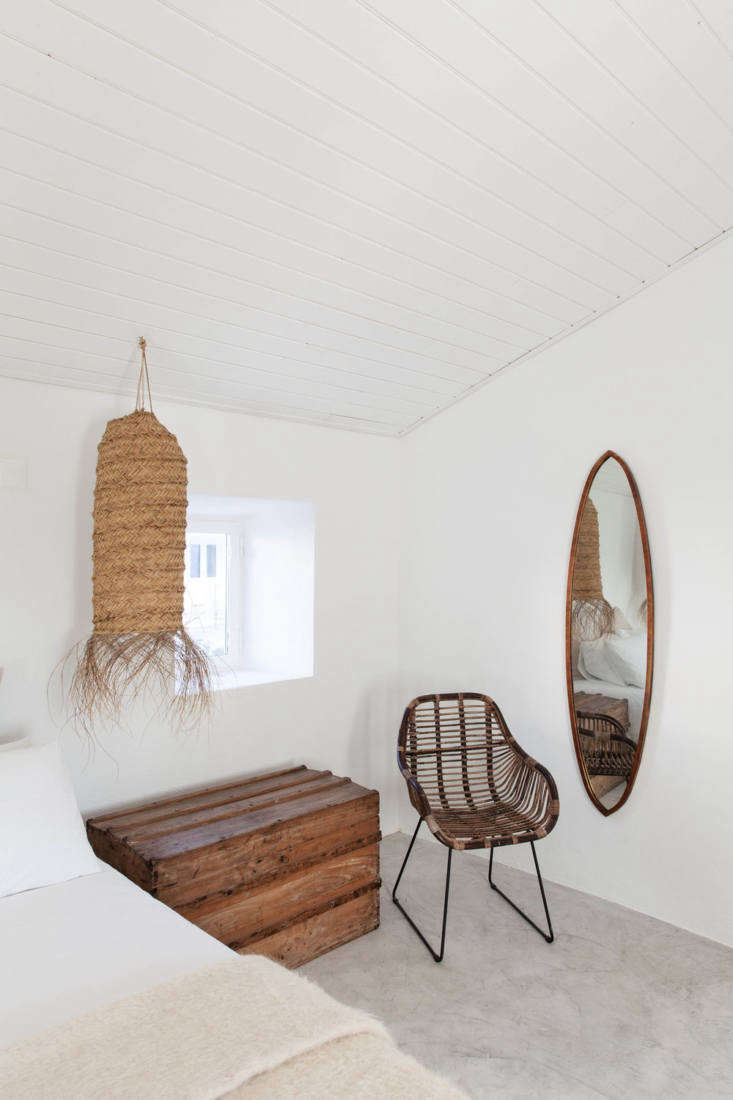 A mohair throw and oversized woven pendant add texture to another bedroom.