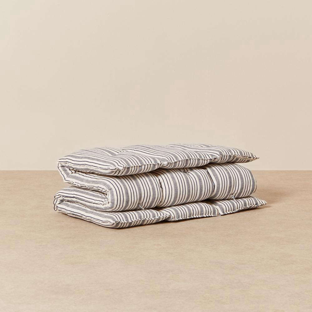 The Kapok Mattress Bedroll by Tensira in navy and off-white is $9 at Goodee. (For more about Goodee, see Byron and Dexter Peart&#8