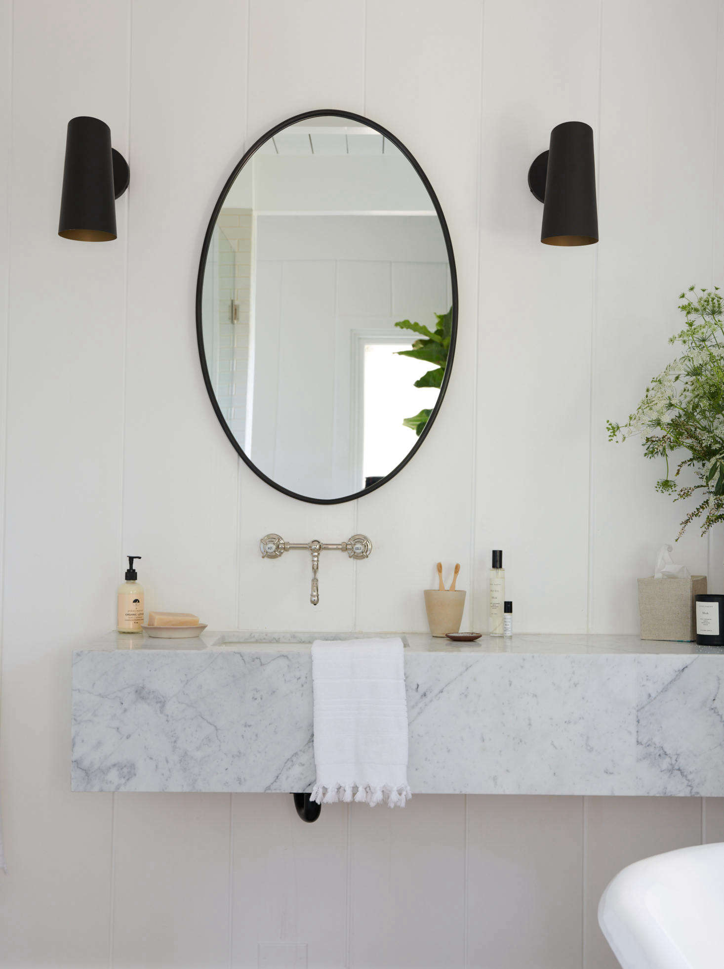 In one of the bathrooms, a slab of marble left over from the kitchen counters was re-fitted into a sink.