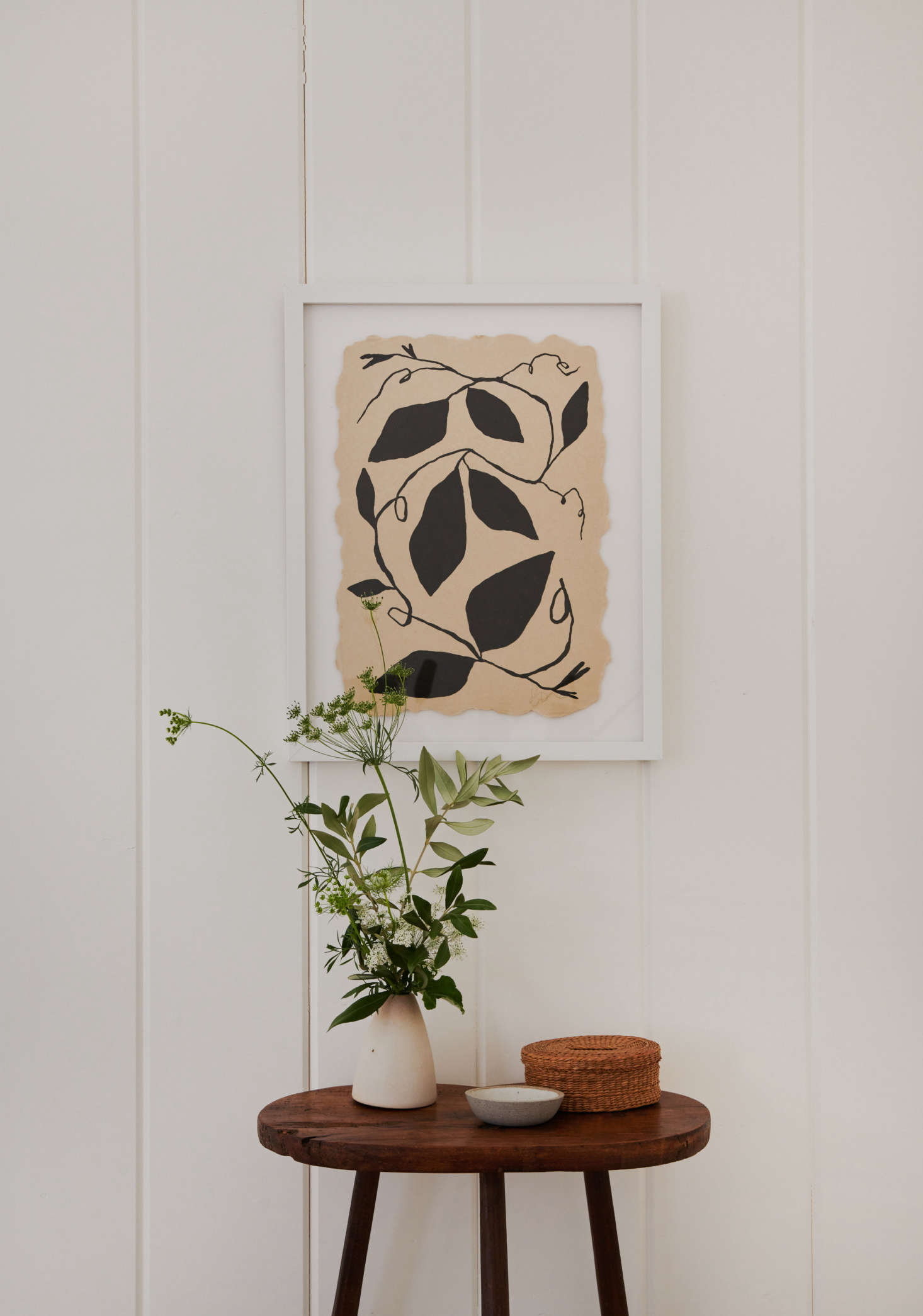 The framed print is by Tennessee-based artist Kate RoebuckviaUprise Art, which provided art throughout the house.
