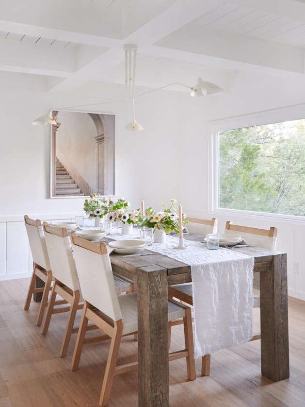 California Style Epitomized An Airy Lakeside House Redone by Jenni Kayne Dining Room in Jenni Kayne Lake House, Photo by Tessa Neustadt