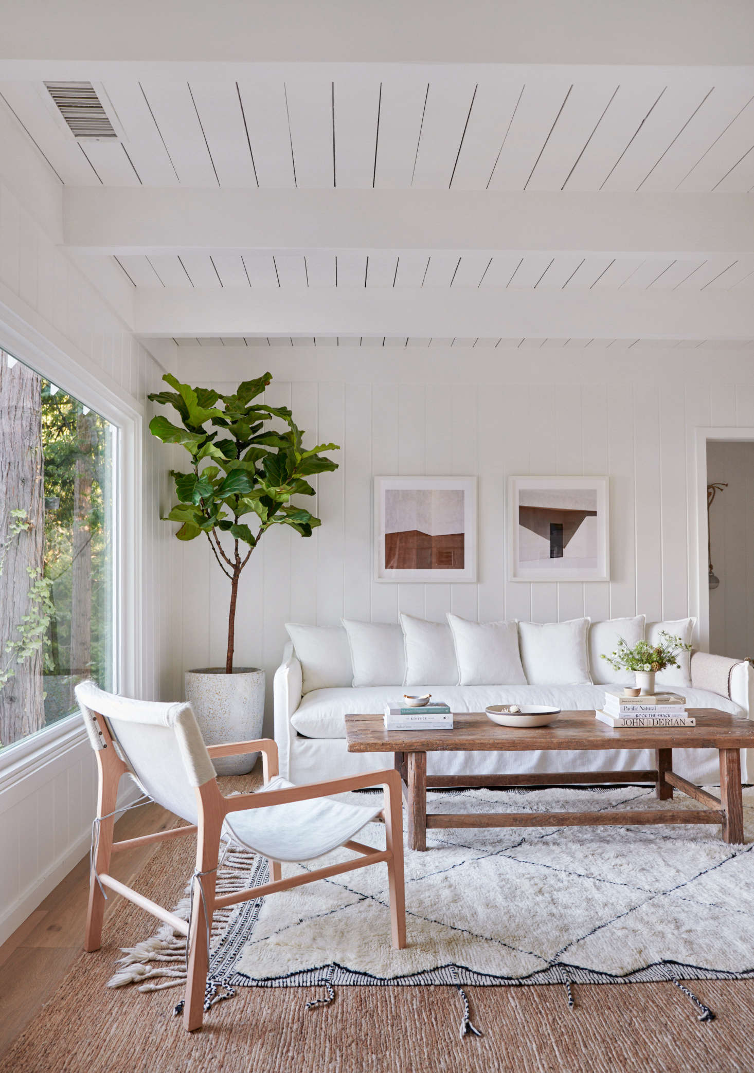 In the living area, theDune sofa and Hayes chairs are both from Maiden Home.