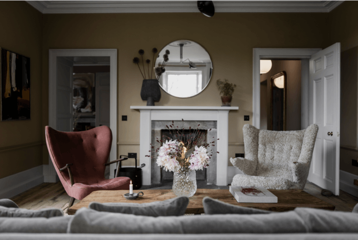 Boucle upholstery makes these armchairs extra-cozy.