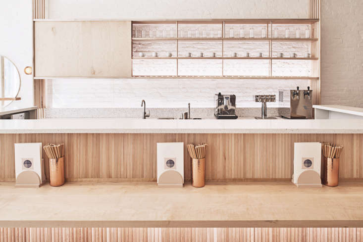 The ledge above the wooden counter is topped with speckled terrazzo.