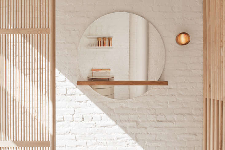 Delicate Japanese-inspired slatted screens are a design motif in the restaurant.