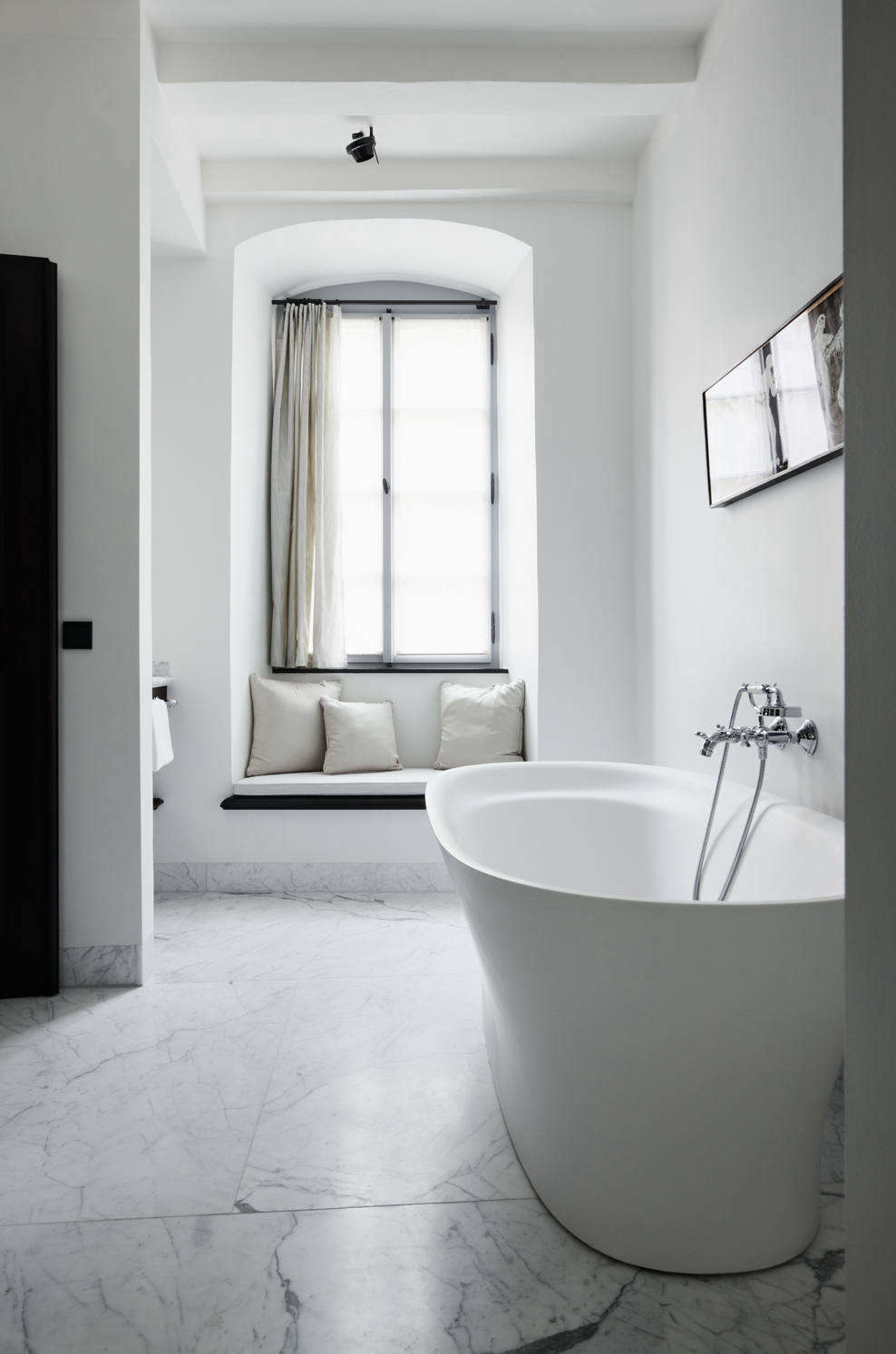 An ensuite bathroom with soaking tub and built-in window seat.