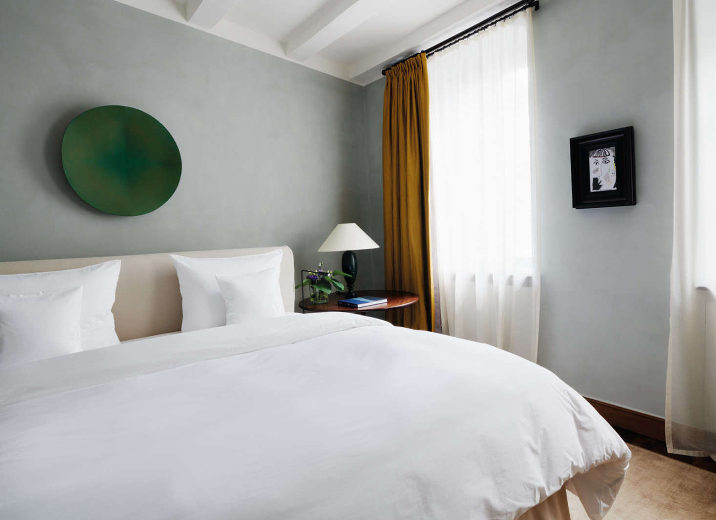 A guest suite rendered in calming colors.