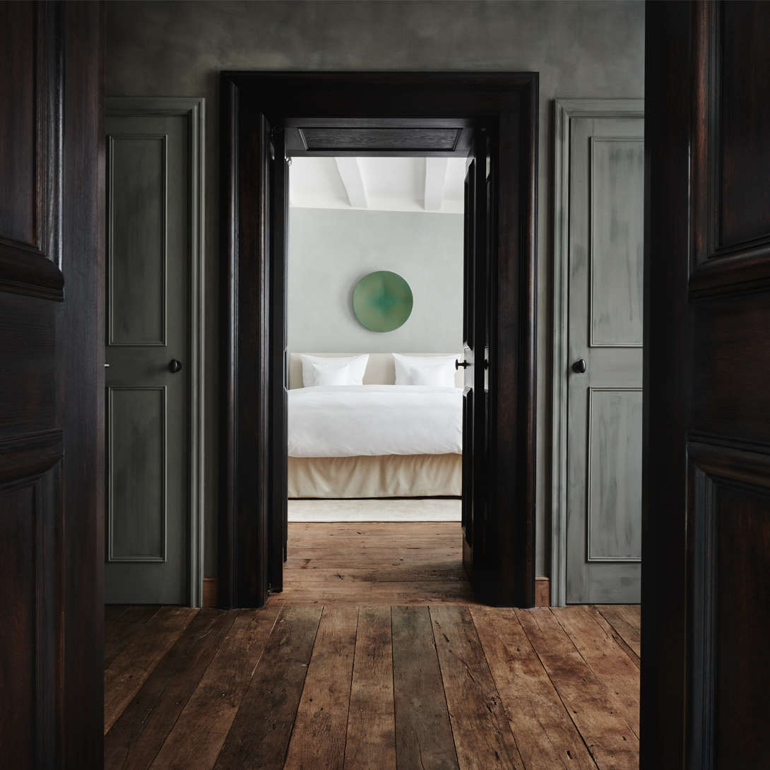 A view into a guest suite;Vervoordt worked with master painter Werner Fraters on the surface finishes on view throughout the hotel.