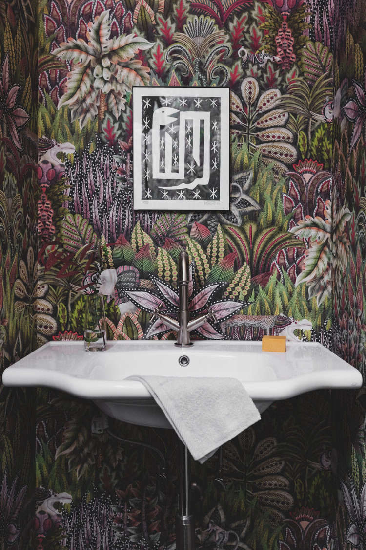 The aforementioned crash course in wallpapering was for the powder room, now cloaked in Cole & Son&#8