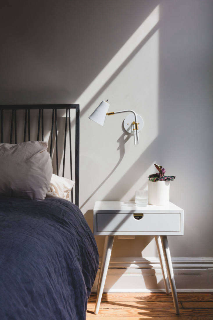 The palette shifts to paler shades upstairs. The master bedroom, shown here, is in Benjamin Moore Picket Fence. Says Andrea: &#8