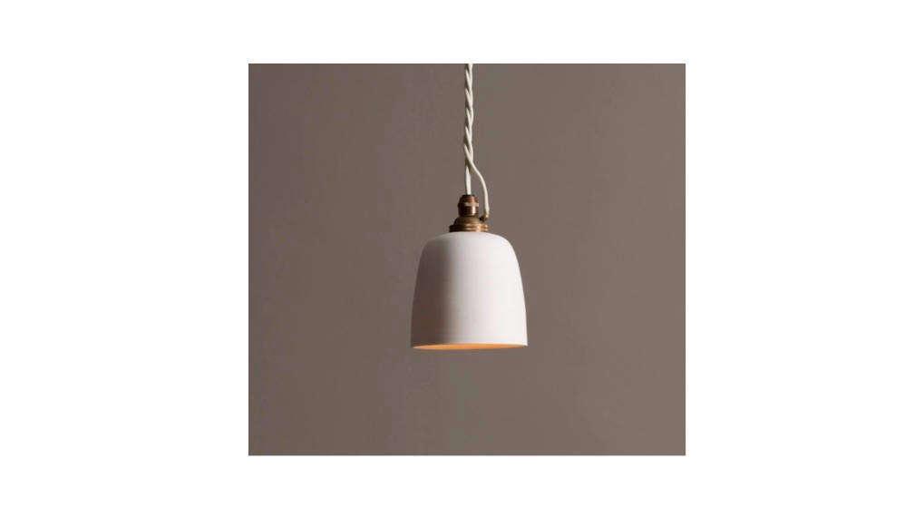 Small porcelain Plain Beaker Lights flank the bed; currently deVOL&#8