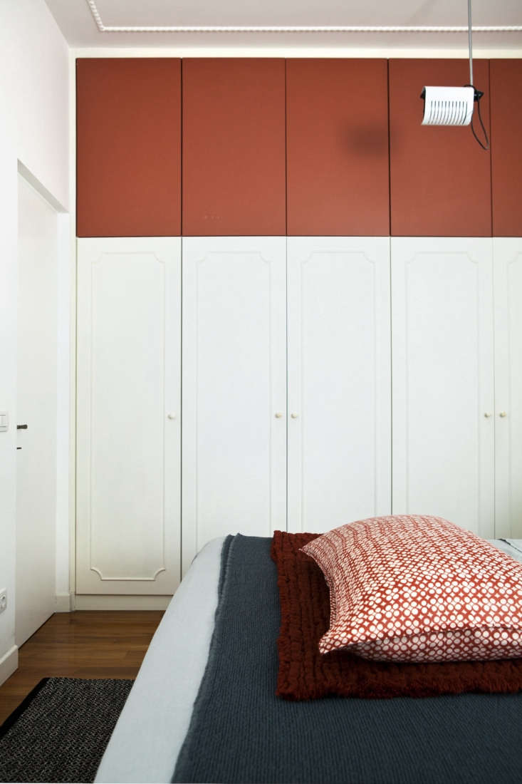 in the bedroom, the architects integrated existing built in wardrobes with an a 19